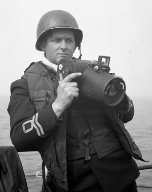 Lieutenant Gilbert Milne of the Royal Canadian Naval Volunteer Reserve, four days before D-Day, with his Fairchild K-20 camera.