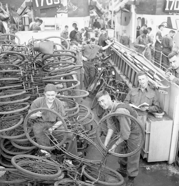 Infantrymen checking bicycles aboard an LCI in Southampton, England.