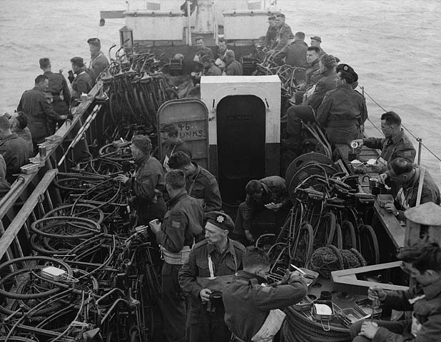 A Gib Milne photo from the bridge of LCI 306, looking at the men and bicycles in the bow.