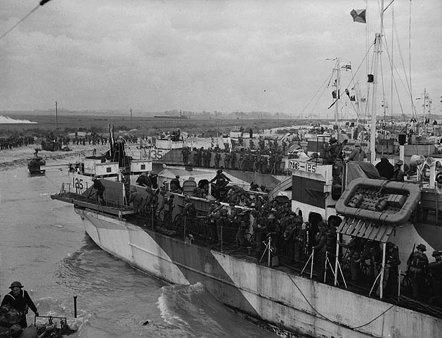 Canadian soldiers from LCI 125 and 135 going ashore on D-Day.