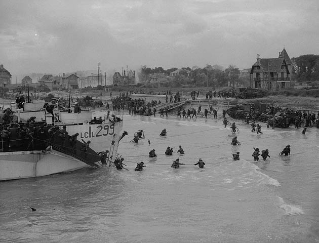 Gib Milne takes this iconic series of shots of LCI 299 on D-Day.