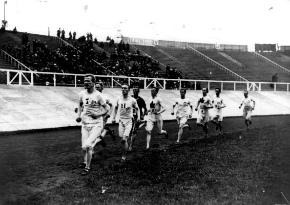 Five Mile Race in White City Stadium on 18th July 1908. Emil Voigt of Great Britain leads the pack on his way to the gold medal.
