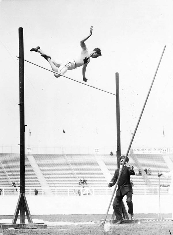Ed Archibald competes in the pole vault competiton. He would tie for bronze.