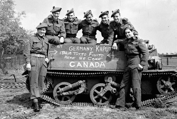 Canadian Soldiers pose at news of surrender
