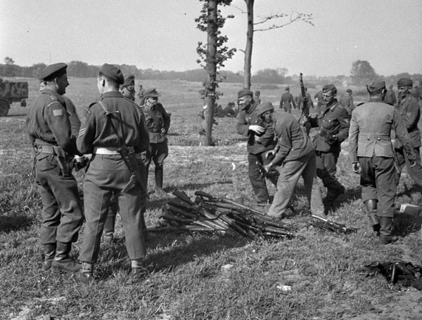 German soldiers handing in weapons