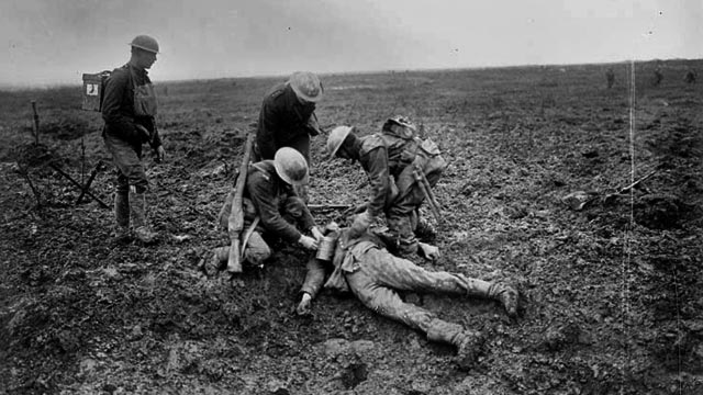 More soldiers look over dead German